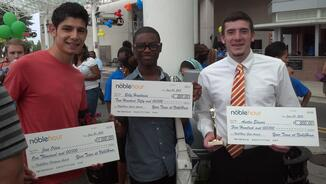 Students receive a scholarship from NobleHour for their volunteer service.
